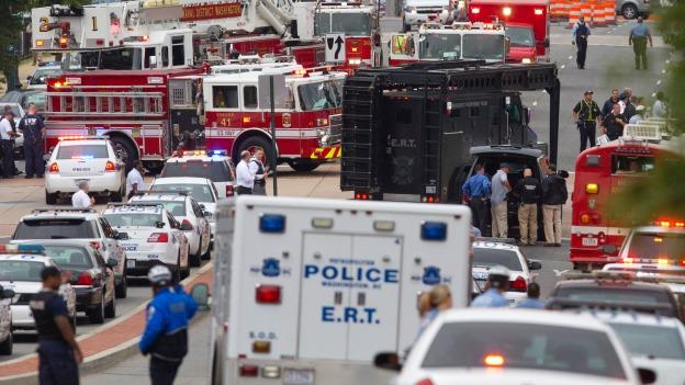 An Emergency Response Team vehicle arrives to the scene where a gunman was reported at the Washington Navy Yard in Washington, on Monday, Sept. 16, 2013.