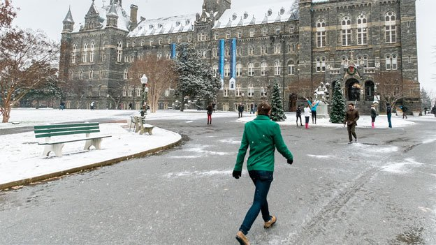 The first round of snow is mostly ice and slush at Georgetown University on Monday, but a second round may actually bring accumulation.