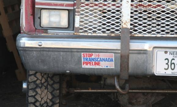 An anti-pipeline bumper sticker on rancher Sue Luebbe's pickup. Four years ago, she stood on the hood of the truck and pointed a rifle at a helicopter that was surveying her land for TransCanada.