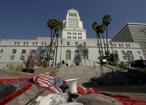 Trash is left behind in the aftermath of the Occupy Los Angeles after the Los Angeles  police broke up the large encampment of protesters who had been camping  out for the past two months at LA City Hall, Wednesday, Nov. 30, 2011,  in Los Angeles. (AP Photo/Gus Ruelas)
