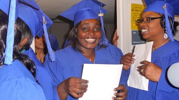 Academy of Hope students Doris Decte (center) and Jeanette Sauls celebrate getting their GED certificates.