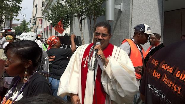Rev. Inocencio Quinones with Our DC participates in a protest against Pepco near the corner of 14th and 8th Streets NW.