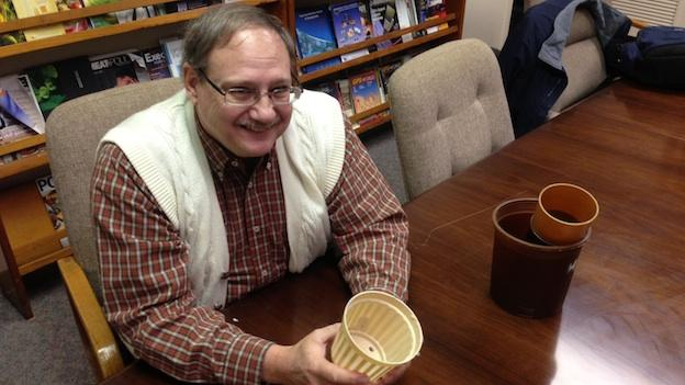 Mark Teffeau, Director of Research at Horticultural Research Institute holds a 100 percent biodegradable nursery pot, made from chicken feathers.