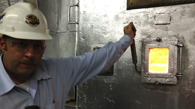 Wheelabrator's Dave Jones outside a burner in the Baltimore plant.