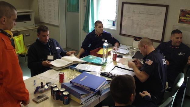 Coast guard inspectors examine the ships records.