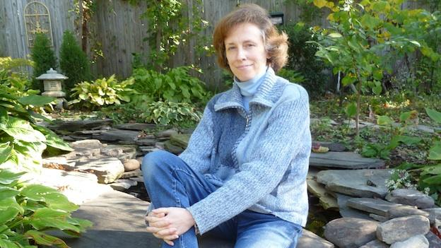 Cindy Kwitchoff relaxes in her backyard garden in Pimmit Hills, Va.