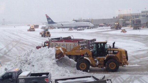 Crews are hard at working trying to keep the runways at area airports in the clear.