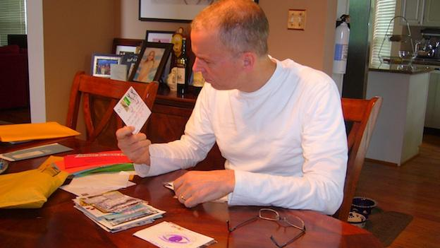 PostSecret founder Frank Warren reads over some of the postcards he's receive.