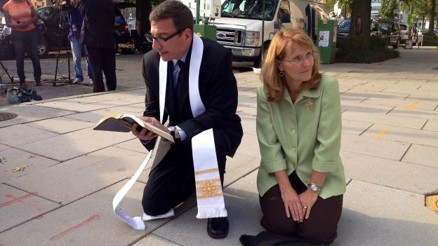 Reverend Rob Schenck and Peggy Nienaber pray at the corner of 3rd and M Streets in Southeast.