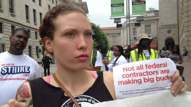 The protesters want federally contracted workers to make a living wage.