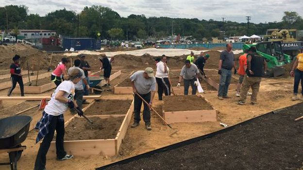 """Volunteers build raised vegetable beds on DCBIA's """"Build Day"""" on Sept. 26."""