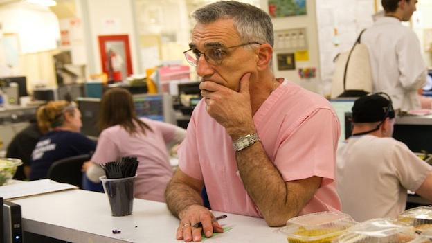 Dr. Thomas Scalea, Physician-in-Chief at the Shock Trauma Center, confers with his staff on a busy Friday evening.