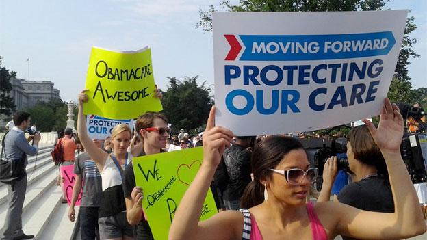 Affordable Care Act supporters celebrate in front of the Supreme Court after the justices upheld the law June 28.