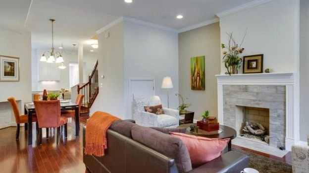 The renovated living room of 1452 Euclid St. NW, a rowhouse long owned by the D.C. Housing Authority that was recently sold for $920,000.