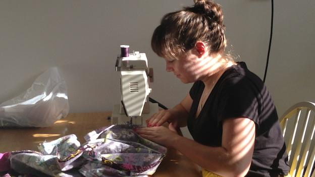 Lauren Talley, 25,  finishes sewing a dress in her apartment in Northwest D.C.