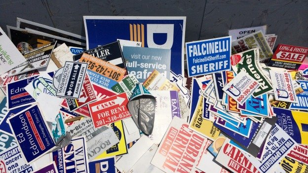 Officials have been removing signs from campaigns and businesses hanging up around Montgomery County.