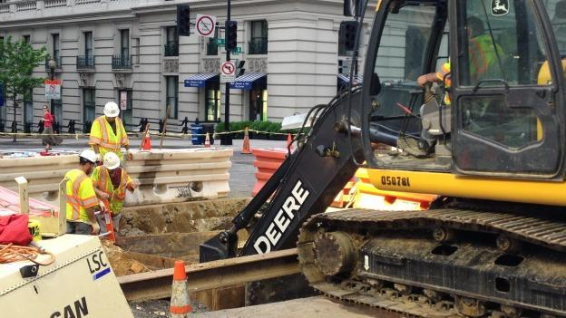 Repairs continue on the 14th Street sinkhole, which is 15 feet deep.