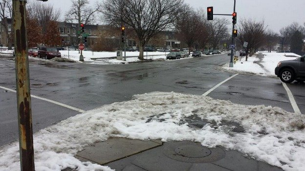 "At this ""sneckdown"" — located at 17th Street and Potomac Avenue SE — the snow shows parts of the roadway not used by cars and that could be replaced with a wider sidewalk, bike lane or plaza."