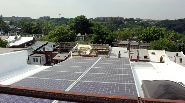 The solar panels on Anya Schoolman's roof in Mt. Pleasant generate a third to two-thirds of her energy a month. Her neighbors have even more advanced arrays.