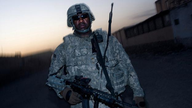 An unidentified African American soldier patrolling in Afghanistan.
