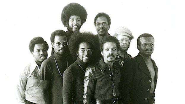 A promotional shot of the Soul Searchers from 1974 shows, from left to right: Keni Scoggins, Lino Druitt, Bennie Braxton, John Buchanan, Chuck Brown, John Euell, Lloyd Pinchback, Donald Tillery.
