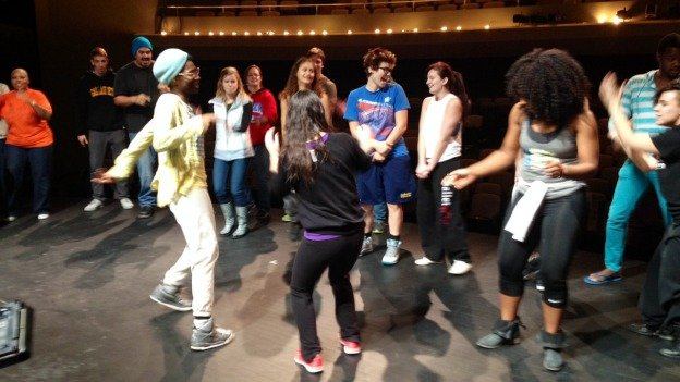 Gallaudet students freestyle with STOMP company members.