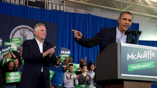 President Barack Obama, right, speaks at a campaign event for Virginia Democratic gubernatorial candidate Terry McAuliffe, left, at Washington-Lee High School in Arlington, Va. on Sunday, Nov. 3, 2013.