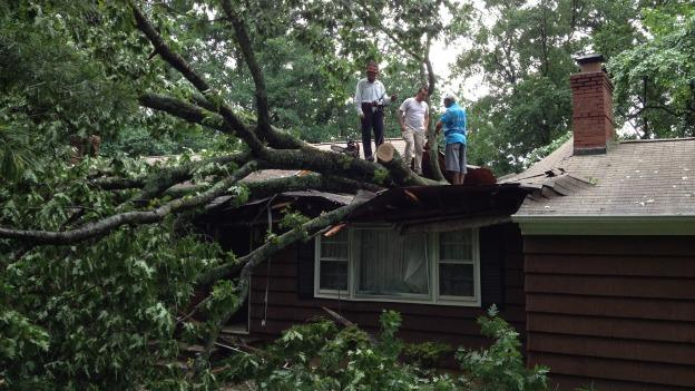 A 65-foot-tall oak tree fell on this house in Sterling, Va. during Thursday afternoon's storms.