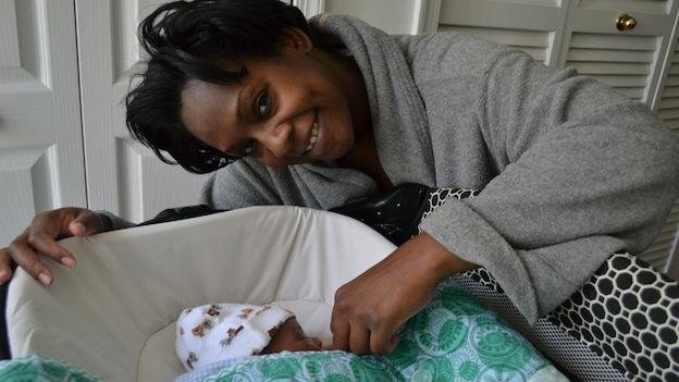 "Twanda Washington, at home in Upper Marlboro, Md. with her 2-week old son, Patrick ""PJ"" Junior."