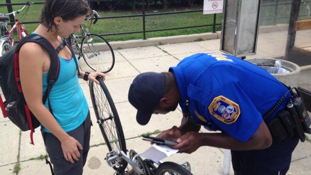 A Metro Transit Police officer registers a bike at the College Park Metro station on Tuesday morning.