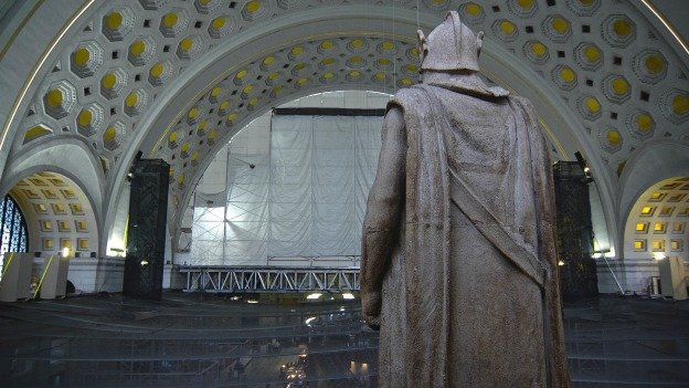 A legionnaire watches over the construction in Union Station's main hall to replace the ceiling's gold.