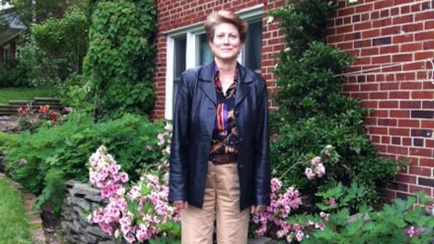 Kathy Hoekstra standing in front of her home in the Lincolnia Hills neighborhood of Alexandria Va.