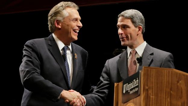 Democratic gubernatorial candidate, Terry McAuliffe, left, shakes the hand of Republican challenger Virginia Attorney General Ken Cuccinelli, right, after a debate at Virginia Tech in Blacksburg, Va., Thursday, Oct. 24, 2013.