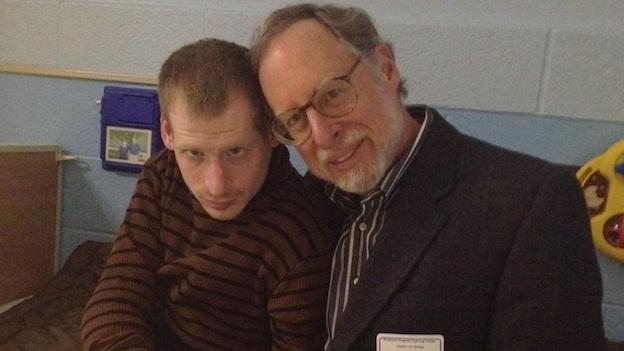 Jason Kinzler, 36, who has Angelman's Syndrome, sits with his father, Peter, at the Northern Virginia Training Center.