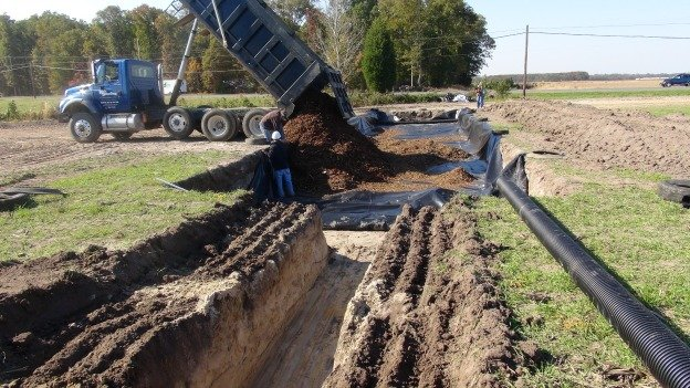 Woodchips are dumped into a lined bioreactor trench at Oakland View Farms on Maryland's Eastern Shore.