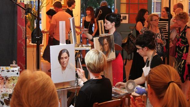 Artists paint before a live audience during last year's Face Off event at Principle Gallery.