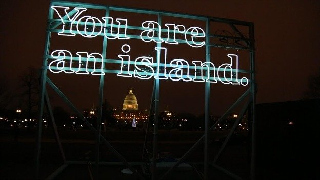 "In conjunction with her solo exhibit's opening, Alicia Eggert mounted ""You are (on) an island,"" an illuminated sculpture,  on a vehicle that drove all over Arlington and D.C. earlier this month."