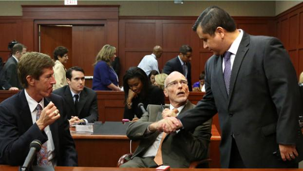 George Zimmerman, right, with his defense counsel, Mark O'Mara, left, and Don West at the Seminole County Criminal Justice Center in Sanford, Fla., Saturday, July 13. (AP Photo/Joe Burbank)