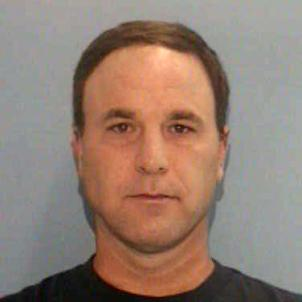 Scott Spear, 47, has been arrested and charged with two counts of committing a fourth-degree sex offense.
