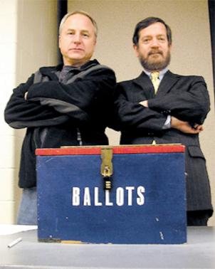 Sheriff Dana Lawhorne, left, and Commonwealth's Attorney Randy Sengel guard the ballot box during a Democratic caucus.