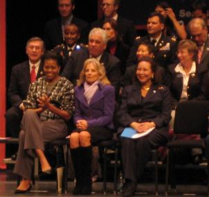 First Lady Michelle Obama sits next to Jill Biden at the inauguration of the veteran community service initiative, Mission Serve.