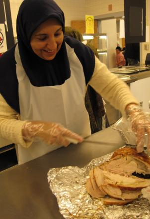 Farida Vaid carves a turkey for the All-Dulles Area Muslim Society charity event in Herndon, Va.