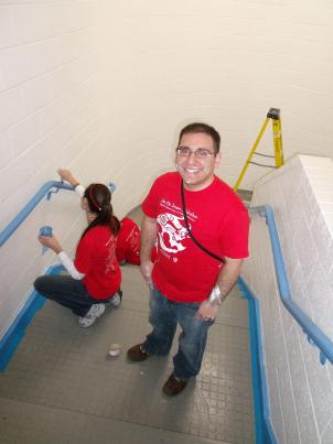 Jesse Rauch of the Young Education Professionals worked in the Boys and Girls Club stairwell along with his team members.