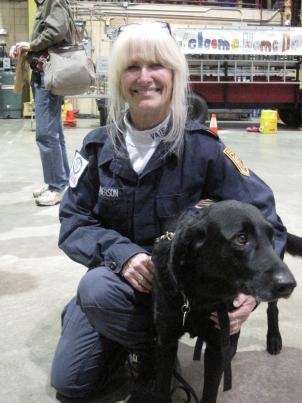 Fairfax County Canine Search Specialist Teresa MacPherson and her dog Banks, finally home after a 15-day mission to Haiti.