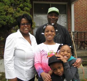 "Darrell Witherspoon stands with his wife Velma and his grandchildren in front of the house he was able to rent in part with the help of a loan through the ""Borrow and Save"" program administered by Neighborhood Housing Services of Baltimore."