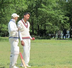 Faisal Usmani, in the red-lined sweater vest, plays cricket on a field near the Tidal Basin. Usmani says many local Pakistanis feel under pressure because of the Times Square suspect.