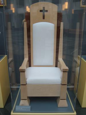 An exhibit of items left behind by Pope Benedict XVI on his visit to D.C., including a chair designed by Catholic University students, reigns supreme in the law school.