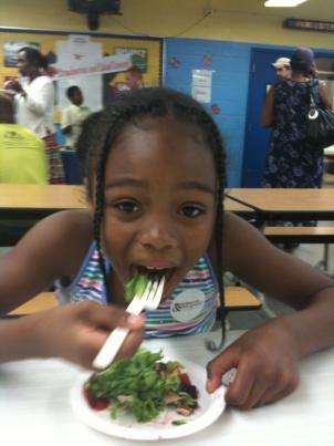 "Iona Green tries a mixed berry salad as part of ""Strawberries and Salad"" Day."