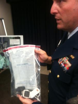 Coast Guard Investigator Matt Jones shows the cellphone used by a crew member to gather evidence used to tip off customs agents.