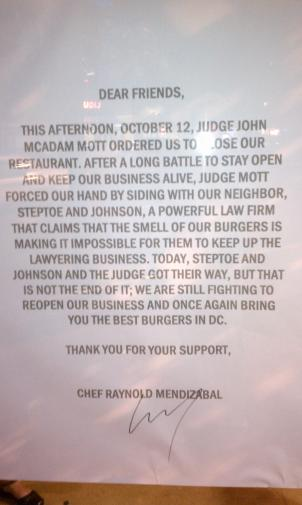 "A sign outside Rogue States on Tuesday alerts customers to a judge's order for them to stop grilling. The sign says the restaurant is ""still fighting to reopen."""